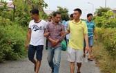 茶榮省Vietcombank銀行劫案的嫌犯阿興被捕。(圖源:互聯網)