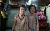 江美(左)與妹妹江秀都患病。