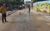 志願者為民鋪路建房