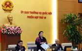國會主席阮氏金銀(中)在會上致開幕詞。(圖源:光慶)