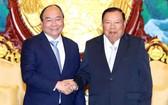 阮春福總理會見老撾總書記、國家主席本揚‧沃拉吉。(圖源:統一)
