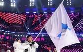 平昌冬奧會開幕式上韓朝代表團舉半島旗共同入場。(圖源:互聯網)