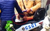 河內市公安廳所屬交警科在查明媒體反映的交警受賄視頻事件。(圖源:視頻截圖)