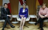 法總統馬克龍、德總理默克爾與英首相特蕾莎‧梅。(圖源:AP)