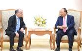 政府總理阮春福(右)接見阿根廷共和國外交與宗教部長豪爾赫‧福列。(圖源:VGP)