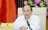 政府總理阮春福在會議上發言。(圖源:光孝)