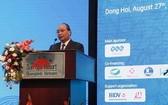 政府總理阮春福在2018年廣平省投資促進會議上致詞。(圖源:陲潘)