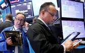 交易員在美國紐約證券交易所工作。(圖源:互聯網)