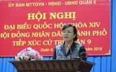 市人民議會主席阮氏決心在與第九郡選民接觸會上答選民質詢。