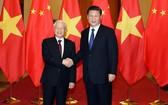 黨中央總書記、國家主席阮富仲(左)與中國共產黨總書記、國家主席習近平。(圖源:越通社)