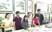 張漢明書畫家開辦的書畫培訓班,於昨(12)日在張畫家的畫廊新春開筆。