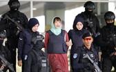 段氏香(中)被判3年4個月監禁。(圖源:新華社)