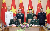 兩國國防部長見證備忘錄簽署儀式。(圖源:越通社)