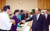 阮春福總理接見私營企業代表。(圖源:越通社)