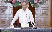 政府總理阮春福在會議上發表講話。(圖源:VGP)