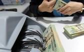 今年前8個月,通過本市各信用組織所得的僑匯收入達36億5000萬美元。(示意圖源:互聯網)