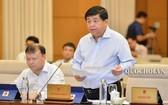 計劃與投資部長阮志勇(前右)在會上發言。(圖源:Quochoi.vn)