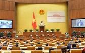 黨十二屆十一中全會結果通知簡報會議場景。(圖源:Quochoi.vn)