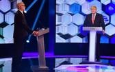 英保守黨(右)與工黨領導人進行大選前電視辯論。(圖源:新華社)