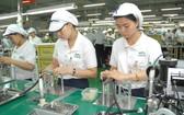 本市新順出口加工區的Nidec Tosok公司生產電子零配件一瞥。