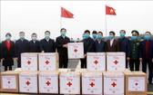 廣寧省向中國廣西省贈送防控疫情輔助物資。(圖源:互聯網)