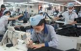 紡織業產銷活動遇到不少困難。(圖源:VNA)