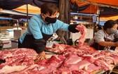 圖為河內市河東傳統市場上的一豬肉零售攤。(圖源:英明)