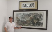馬順通與他為慈善認購的名畫。