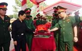 越南志願軍與專家烈士骸骨移葬儀式。(圖源:允和)