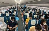 越南航空局:自本月18日至下月15日期間,預計將有21班機運送越南公民從國外回國。(示意圖源:D. Ngọc)
