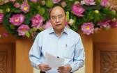 政府總理、價格調度國家指委會主任阮春福主持會議並發表講話。(圖源:光孝)