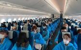 乘搭越航波音787-10夢想客機飛往南京的中國乘客。(圖源:VNA)