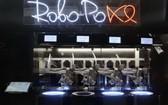 一台機器人廚師正在做菜。(圖源:互聯網)