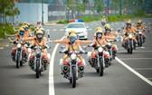 市公安廳所屬58名女交警護送隊昨(25)日舉辦問世儀式。孟玲