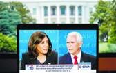 共和黨籍現任副總統彭斯(右)與民主黨副總統候選人哈里斯電視辯論。(圖源:新華社)