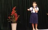 阮李雪明小學生參加比賽。