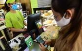 消費者以電子錢包結算。