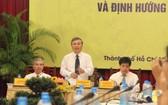 內務部副部長阮仲丞(中)在科研會上發言。(圖源:梅花)