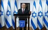 12月22日,以色列總理內塔尼亞胡在耶路撒冷發表電視講話。(圖源:新華社)