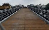 第十二郡的安富東鋼橋項目進入了尾段,預計將於本月31日通車。(圖源:Đ.T)
