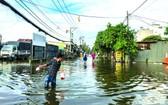 守德市協平政坊38號路嚴重受淹,導致民眾日常生活與出行遇到不少困難。(圖源:互聯網)