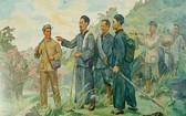 這幅畫描繪了胡志明主席在奔波海外尋找救國道路30年之後,1941年1月28日,回國就落腳在高平省河廣縣長河鄉北坡村並在這裡直接領導越南革命。(圖源:Hochiminh.vn)