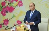 政府總理阮春福主持會議並發表講話。(圖源:光孝)