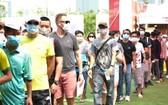 第四季Techcombank 胡志明市國際馬拉松比賽吸引逾1萬3000名運動員報名參加。(圖源:孟好)
