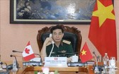 國防部長潘文江上將與加拿大國防部長哈爾吉特‧辛格‧薩詹互通電話交談。(圖源:越通社)