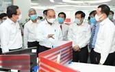 國家主席阮春福看望《西貢解放報》。(圖源:越勇)