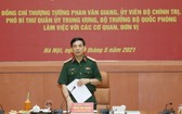 國防部部長潘文江上將在會議上發言。(圖源:仁義)