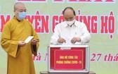 國家主席阮春福捐助支援疫情防控。(圖源:越通社)
