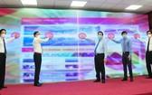 《越南共產黨電子報》新版面和應用程式亮相儀式。(圖源:潘草)