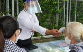 市嘉安115醫院從大門就採取防疫措施。